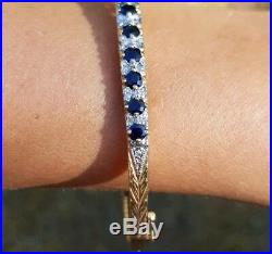 9ct yellow gold bangle set with diamonds 0.22ct and sapphires. Perfect gift