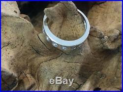 Diamond half eternity ring. 9ct white gold eternity set with 7 perfect diamonds