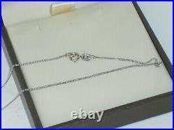 GOLDSMITHS 9ct white gold 0.15ct tension set diamond solitaire necklace, perfect