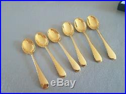 Set of 6 solid silver gold plated spoons in original case. Perfect condition