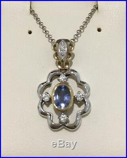 Yellow and White Gold Pendant set with a sapphire and diamonds perfect